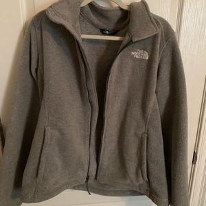 gray North Face zip up jacket